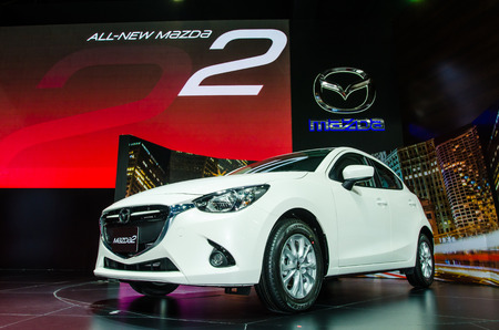 mazda: NONTHABURI - MARCH 24: Mazda 2 car on display at Thailand 36th Bangkok International Motor Show 2015 on March 24, 2015 in Nonthaburi, Thailand. Editorial