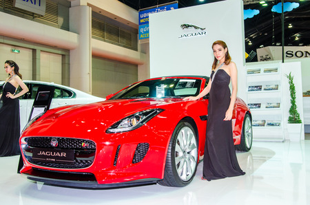 easing: NONTHABURI - MARCH 24: Jaguar F-Type with Unidentified model  on display at Thailand 35th Bangkok International Motor Show 2015 on March 24, 2015 in Nonthaburi, Thailand.