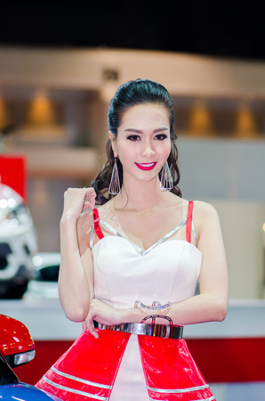 easing: NONTHABURI - MARCH 24: Unidentified model  with MG on display at Thailand 35th Bangkok International Motor Show 2015 on March 24, 2015 in Nonthaburi, Thailand.