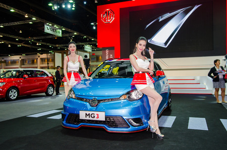 easing: NONTHABURI - MARCH 24: MG3 with Unidentified model on display at Thailand 35th Bangkok International Motor Show 2015 on March 24, 2015 in Nonthaburi, Thailand. Editorial