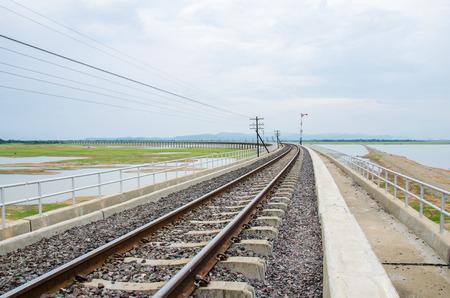 pa: Railroad tracks into the reservoir Pa Sak Jolasid Dam Lopburi Thailand.
