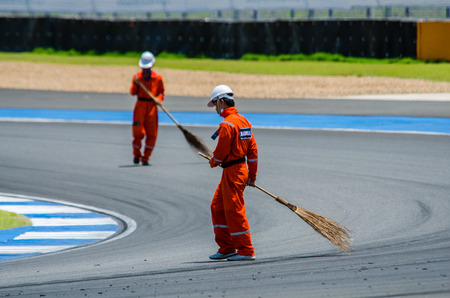 marshal: BURIRAM - JUNE 20: Marshal was sweeping the road to prepare for The 2015 Autobacs Super GT Series Race 3 on June 20, 2015 at Chang International Racing Circuit, Buriram Thailand. Editorial
