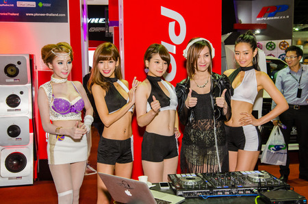disk jockey: NONTHABURI - JUNE 24 : Unidentified model of japan with Disk Jockey on display at Bangkok International Auto Salon 2015 is Aseans biggest and most Exciting Modified Car Show on June 24, 2015 in Nonthaburi, Thailand.