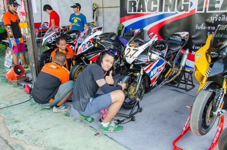 skilled: NAKHON PATHOM - JULY 25 : Unidentified auto mechanic repaired motorcycle on display in Thailand SuperBikes Championship 2015 Round 1 at Thailand Circuit, on July 25, 2015 in Nakhon Pathom, Thailand. Editorial
