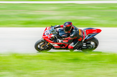 skilled: NAKHON PATHOM - JULY 25 : Pattharapong W. with Yamaha R1 motorcycle in Thailand SuperBikes Championship 2015 Round 1 at Thailand Circuit, on July 25, 2015 in Nakhon Pathom, Thailand. Editorial