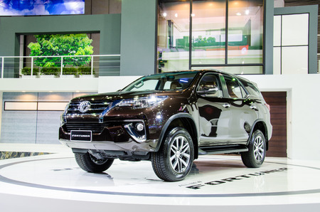 new motor vehicles: BANGKOK - AUGUST 1 : Toyota Fortuner All New on display at Bangkok International Grand Motor Sale 2015 Big Motor Sale 2015 is exhibition of vehicles for sale on August 1, 2015 in Bangkok, Thailand. Editorial