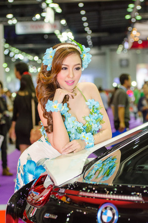 easing: BANGKOK - AUGUST 1 : Unidentified model with BMW on display at Bangkok International Grand Motor Sale 2015 Big Motor Sale 2015 is exhibition of vehicles for sale on August 1, 2015 in Bangkok, Thailand.