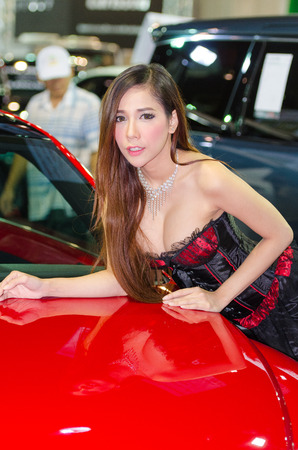 easing: BANGKOK - AUGUST 1 : Unidentified model with auto on display at Bangkok International Grand Motor Sale 2015 Big Motor Sale 2015 is exhibition of vehicles for sale on August 1, 2015 in Bangkok, Thailand.
