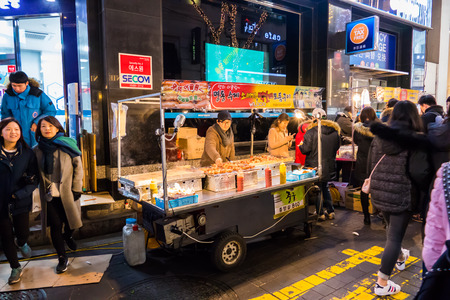 SEOUL - JANUARY 30: Korean people and tourists walking shopping at Myeongdong Market shopping street It is popular and latest fashion center of Korea on January 30, 2016 at Myeongdong Market in Seoul, South Korea. 에디토리얼