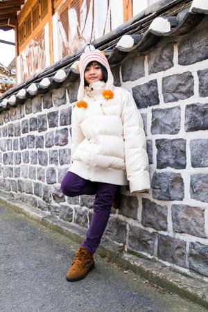 Portrait of cute fashionable children in overcoat on winter.