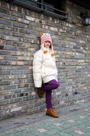 overcoat: Portrait of cute fashionable children in overcoat on winter.