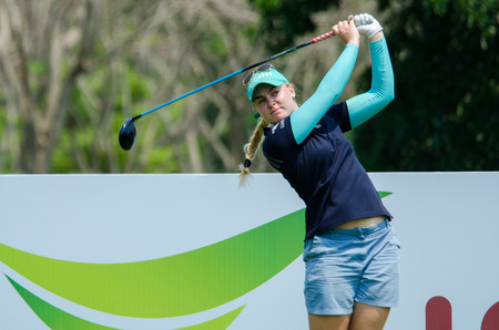 tee off: CHONBURI - FEBRUARY 27 : Charley Hull of England in Honda LPGA Thailand 2016 at Siam Country Club, Pattaya Old Course on February 27, 2016 in Chonburi, Thailand.