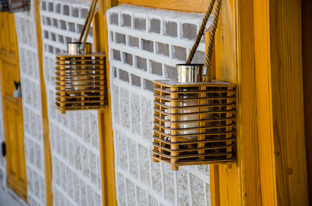 korean style house: Old lantern in front house of Bukchon Hanok, traditional Korean style architecture of village at Seoul, South Korea.