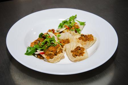 thai basil: Thai basil pork stir fry (stir-fried pork and basil) in mini basket. Thai cuisine.