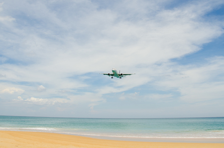airplane landing: Airplane landing at airport, runway near the beach.