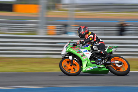 racetrack: BURIRAM - DECEMBER 4 : THaned Boonruang of Thailand with Honda CBR300R motorcycle of CBR300R Thailand Dream Cup in Asia Road Racing Championship 2016 Round 6 at Chang International Racing Circuit on December 4, 2016, Buriram, Thailand.