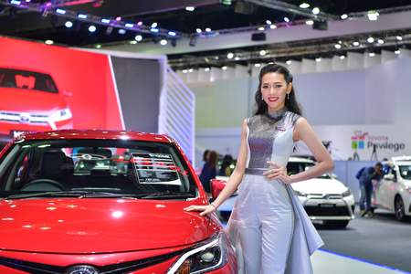 NONTHABURI - MARCH 28: Unidentified model with Toyota New Vios car on display at The 38th Bangkok International Thailand Motor Show 2017 on March 28, 2017 Nonthaburi, Thailand. Editorial