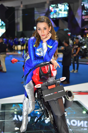 NONTHABURI - MARCH 28: Suzuki GSX-R150 motorcycle with unidentified model on display at The 38th Bangkok International Thailand Motor Show 2017 on March 28, 2017 Nonthaburi, Thailand.