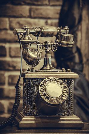 Brass antique vintage analog telephone, concept backgrounds object retro. Stock Photo