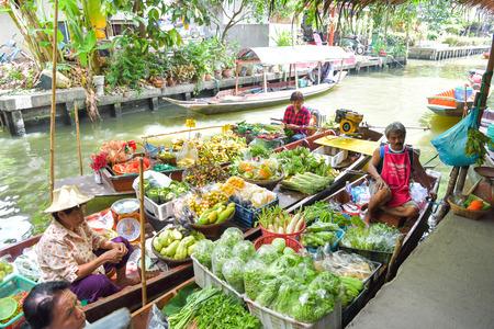 BANGKOK - JULY 29 : Farmer selling fruit vegetable and food on boats at Khlong Lat Mayom floating market, famous and popular among locals and tourists, on July 29, 2018 at Bangkok, Thailand. Editorial