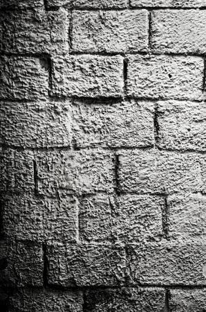 Old black and white painted brick wall 版權商用圖片