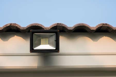 LED flood light, spot light on the roof with blue sky background