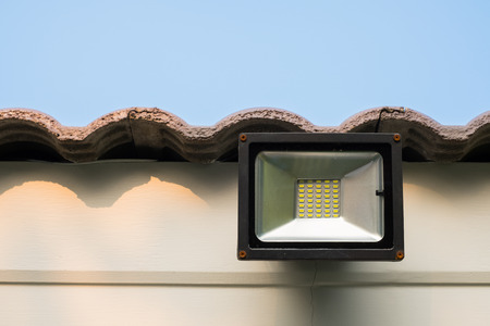 LED flood light, spot light on the roof with blue sky background