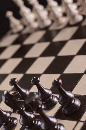 Chess pawns on the chessboard. Closeup
