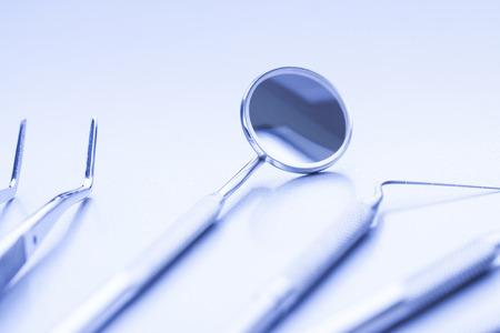 Closeup of professional dental tools in medical light