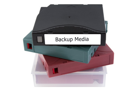 Backup tape for data recovery in server room isolated on white background
