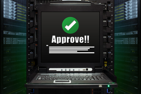 Apporve message show on the server computer display in the modern interior of data center. Super Computer, Server Room.