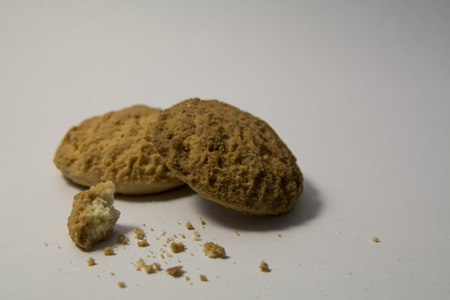 palate: Two baked cookies with crumbs Stock Photo