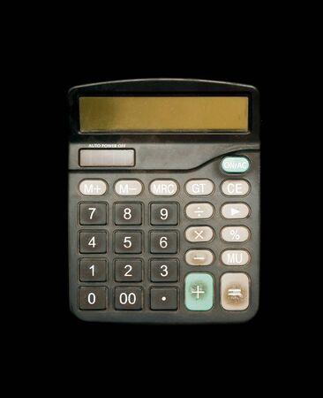 Black standard calculator on a black