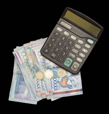 Calculator and money. Money of the Kazakh national currency in tenge with a par value of 10000