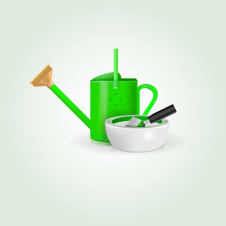 Green watering can, white bowl and shovel  photo