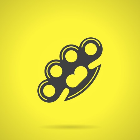 knuckles: Flat black silhouette vector icon for brass knuckles weapon for self-defense on yellow background.