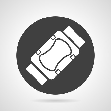 elbow bandage support: Flat black round vector icon with white silhouette knee or elbow protection on gray background.