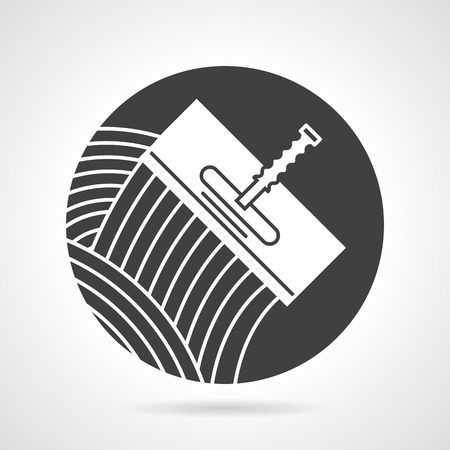 Flat round black vector icon with white contour trowel for tiling on gray background.