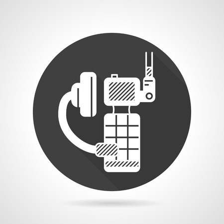 portable radio: Single black round flat design vector icon with white silhouette portable radio system with headphone for outdoor sports and security on gray background. Illustration