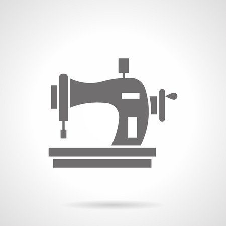 glyph: Manual sewing machine with thread spool. Tailor equipment, homemade crafts and hobbies to sewing fashionable clothes. Symbolic black glyph style vector icon.