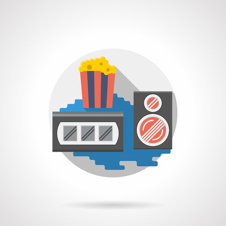 videocassette: Full disposable striped cup with popcorn, videocassette and audio speaker. Media and entertainment accessories. Cinema and movie theme, retro style. Round detailed flat color style vector icon.