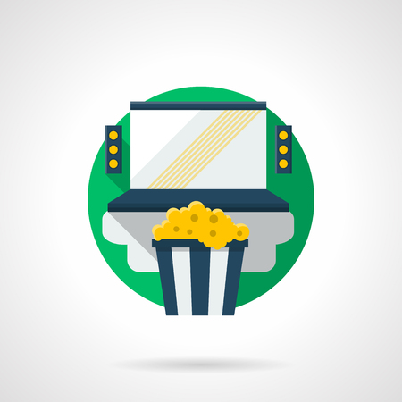 home cinema: Blue laptop with audio speakers and cup with popcorn. Home cinema system. Watching movies online. Round detailed flat color style vector icon. Web design elements.