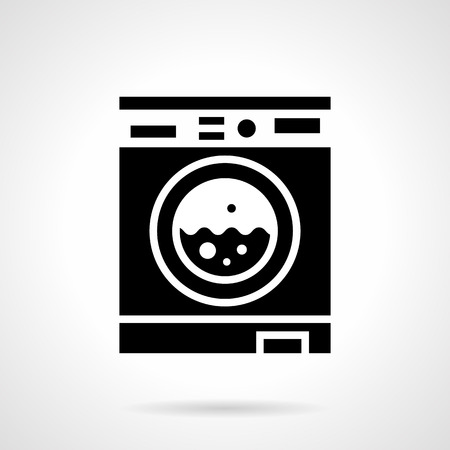 Abstract monochrome symbol of working washing machine. Laundry room and cleaning clothes services. Symbolic black glyph style vector icon.