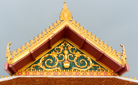 Buddhist temple roof detail in Thailand. photo