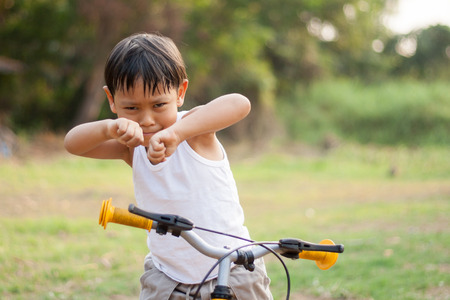 confide: happy young asia boy  playing kungfu having fun Stock Photo