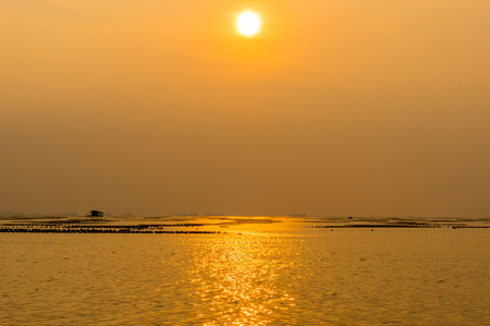 aquaculture: The atmosphere during sunset In the area of aquaculture in the sea Stock Photo