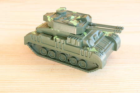 green plastic soldiers: close up of toy military tank green color Stock Photo