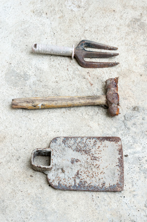 old tools: used old tools on cement background