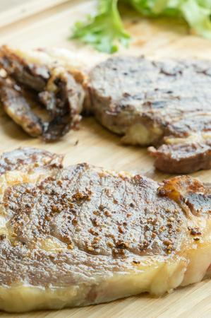 beefsteak: beefsteak on wood plate Stock Photo