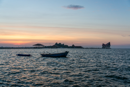 Koh Loi in during sunset from public park of sriracha view point, chonburi province